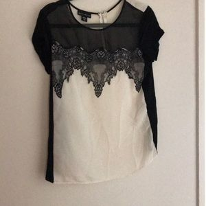 Sheet black lace and cream blouse